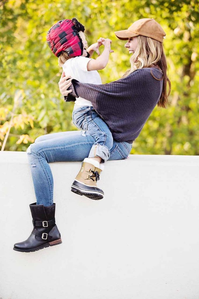 lifestyle blogger of the motherchic wearing sorel boots