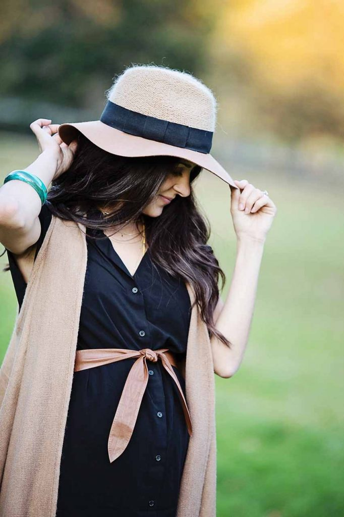 abby of the motherchic wearing floppy hat