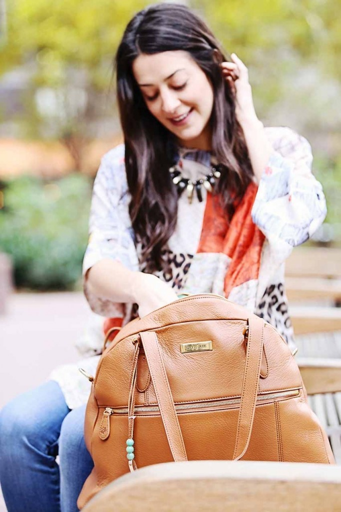 the motherchic wearing lily jade bag