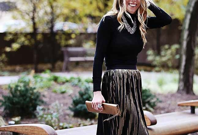 the motherchic wearing baublebar collar necklace and metallic midi skirt