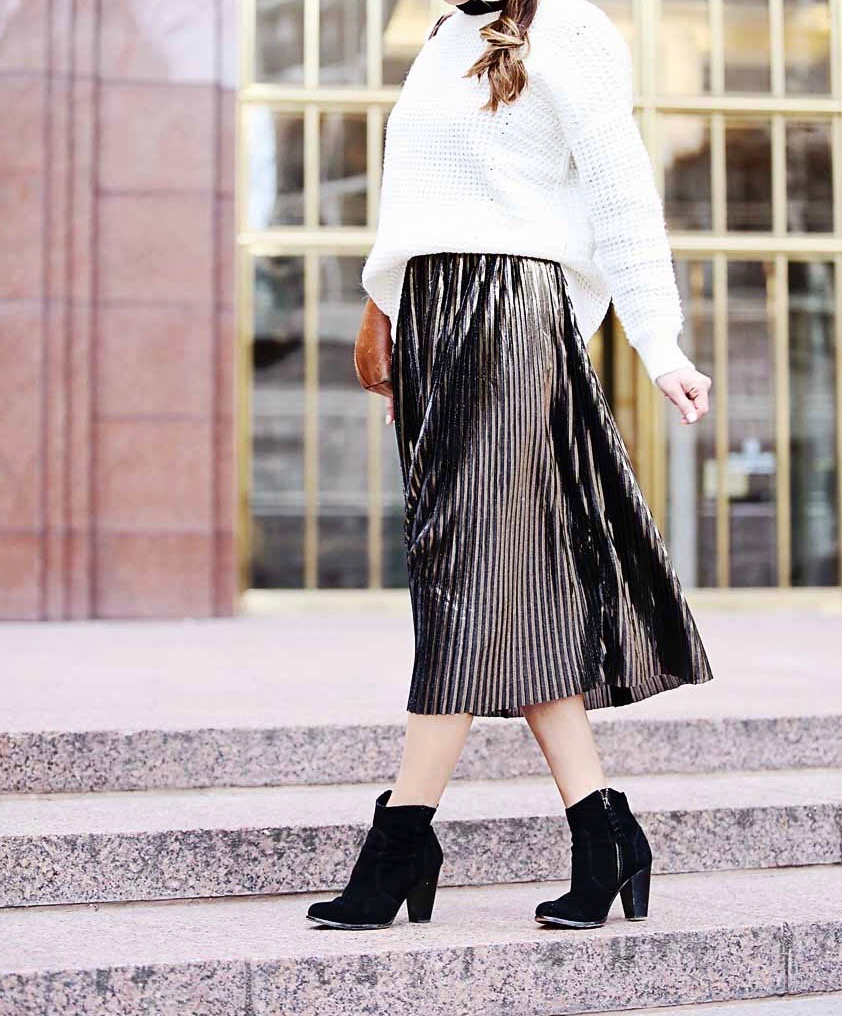 the motherchic wearing metallic midi skirt and booties