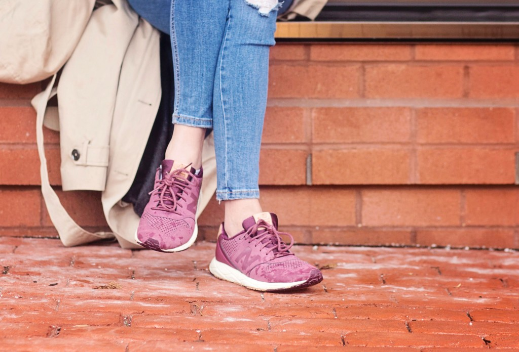 The motherchic wearing boysenberry new balance sneakers