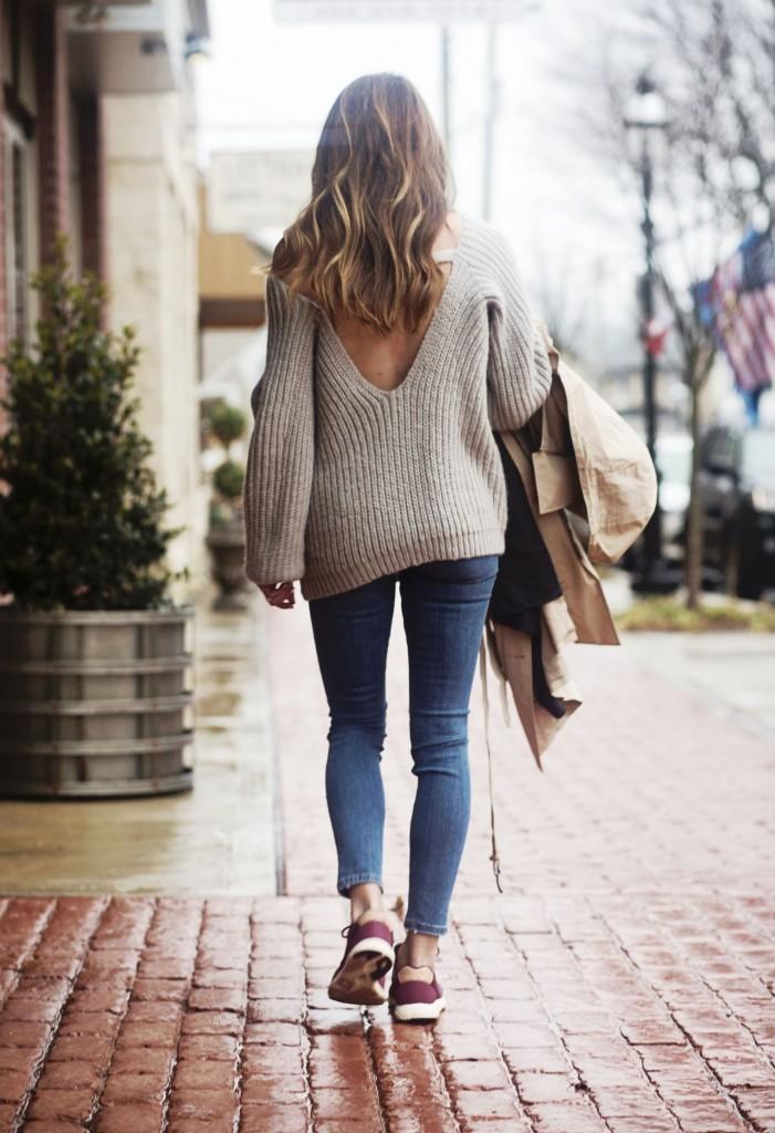 the motherchic wearing open back date night sweater