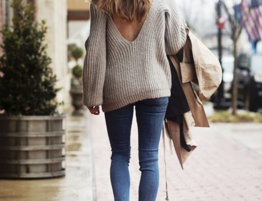the motherchic wearing open back sweater