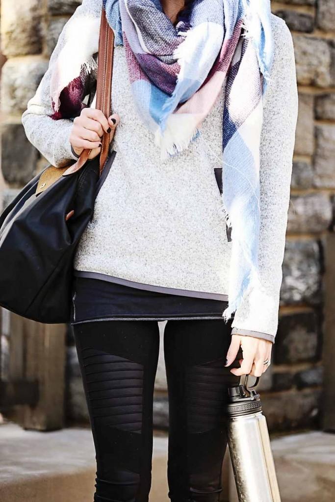 the motherchic wearing alo leggings and lululemon hoodie