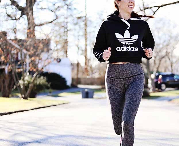the motherchic wearing adidas cropped sweatshirt and lululemon high rise pants
