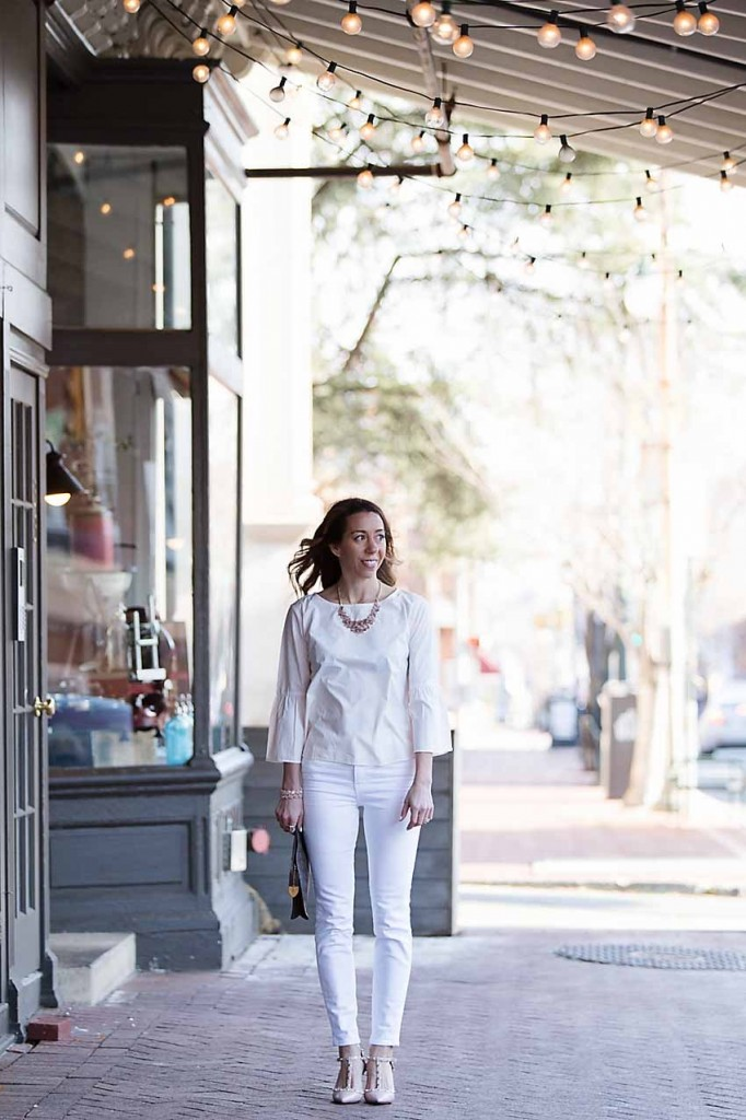 the motherchic wearing madewell white denim and bell sleeve top