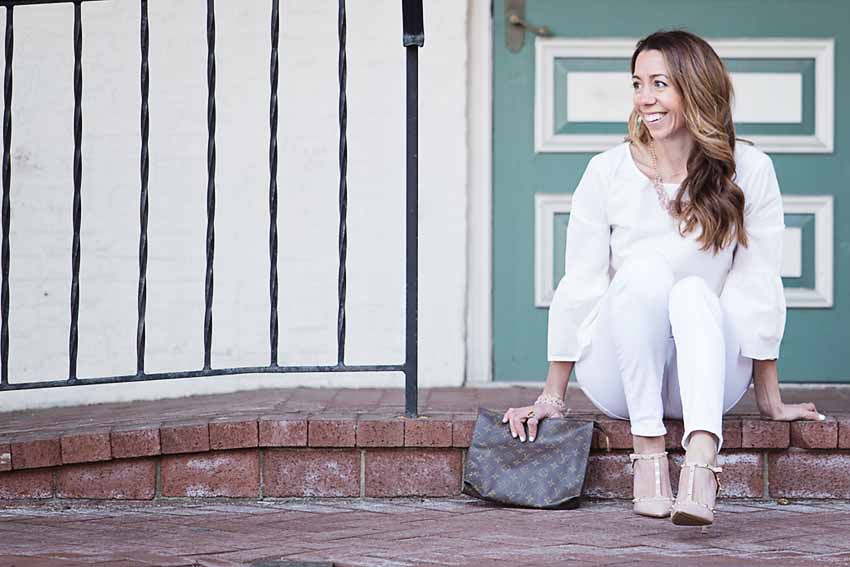 the motherchic wearing bell sleeve top and blush heels