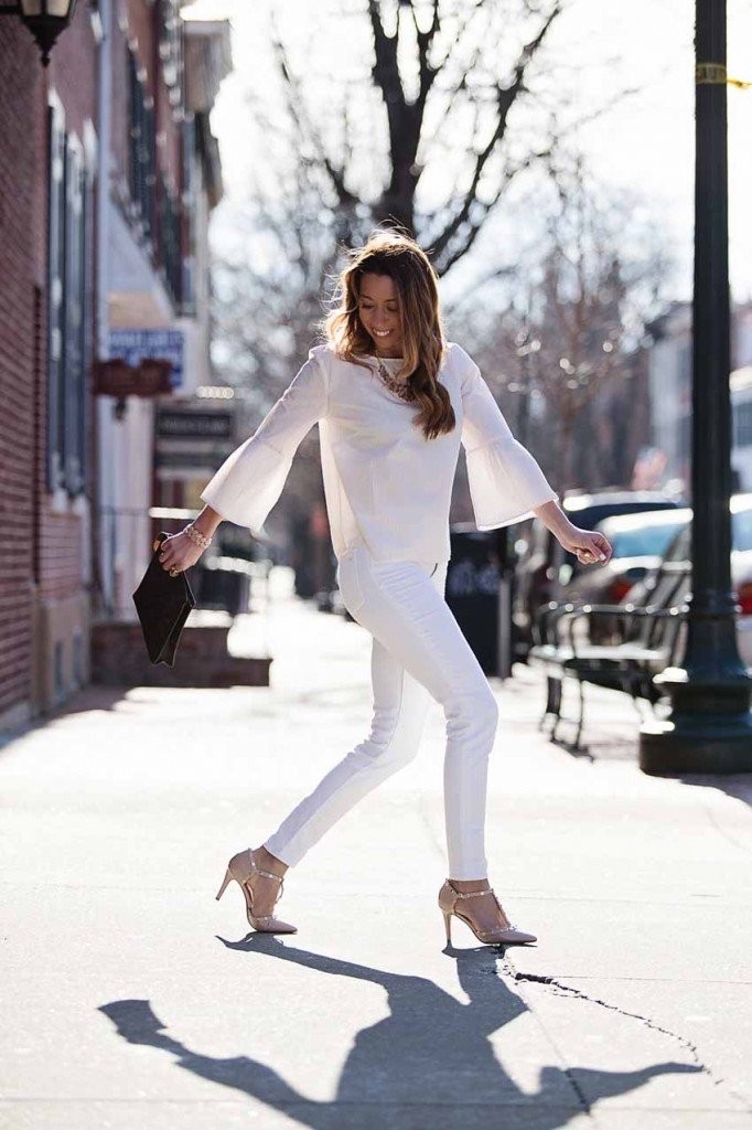 the motherchic wearing madewell bell sleeve top and white denim