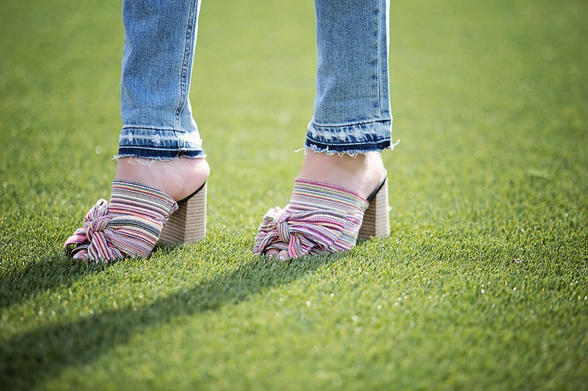 the motherchic wearing sam edelman statement sandals and rag and bone jeans