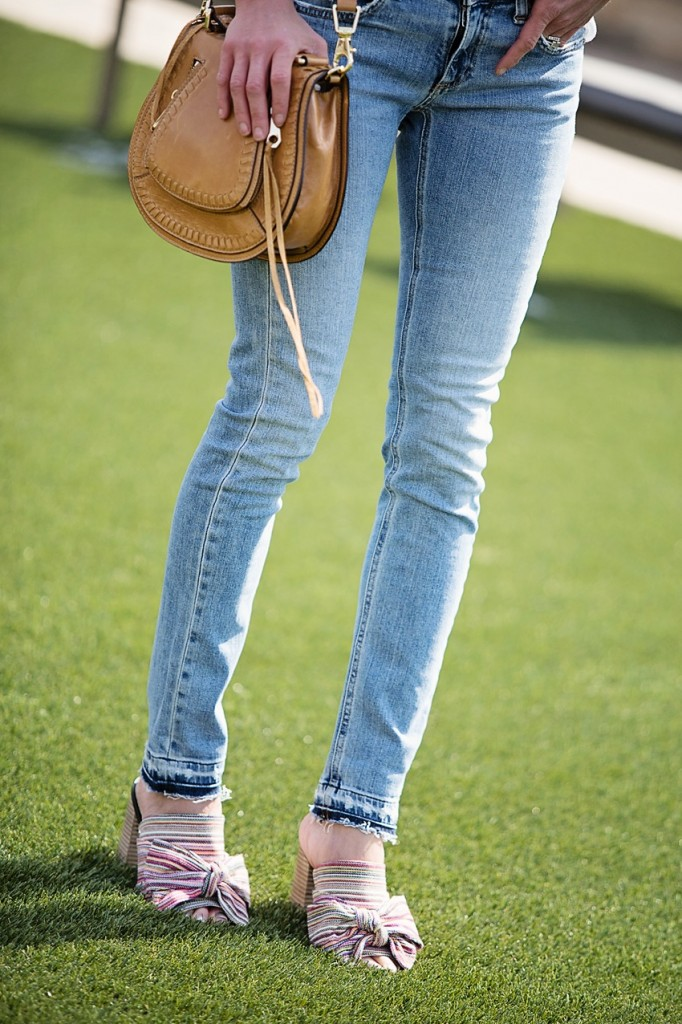 the motherchic wearing rag and bone jeans and statement sandals