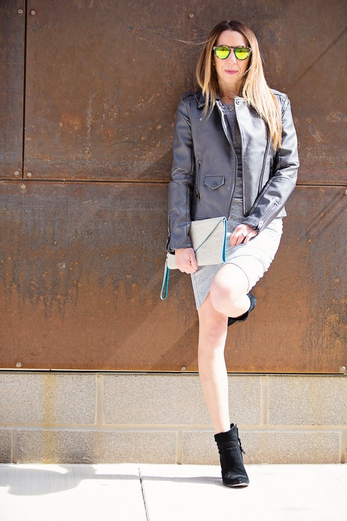 the motherchic wearing tank dress and faux leather jacket