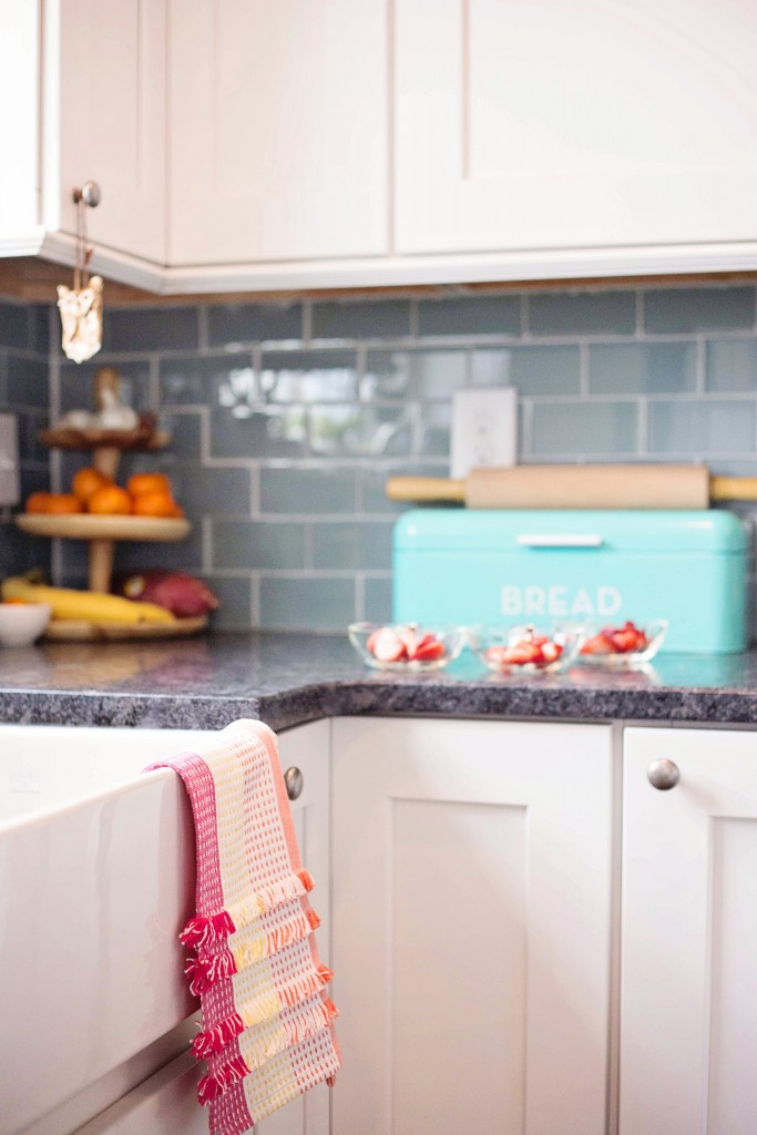motherchic kitchen with teal bread box and anthropologie dish towels