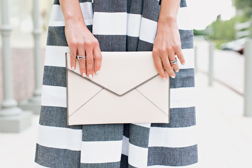 the motherchic wearing rebecca minkoff envelope clutch