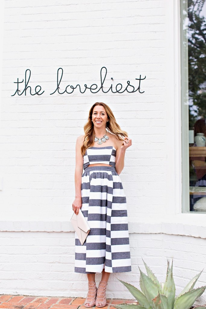 The motherchic wearing striped midi dress for wedding guests