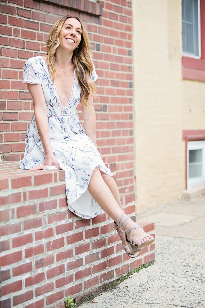 The Motherchic wearing a romantic floral maxi