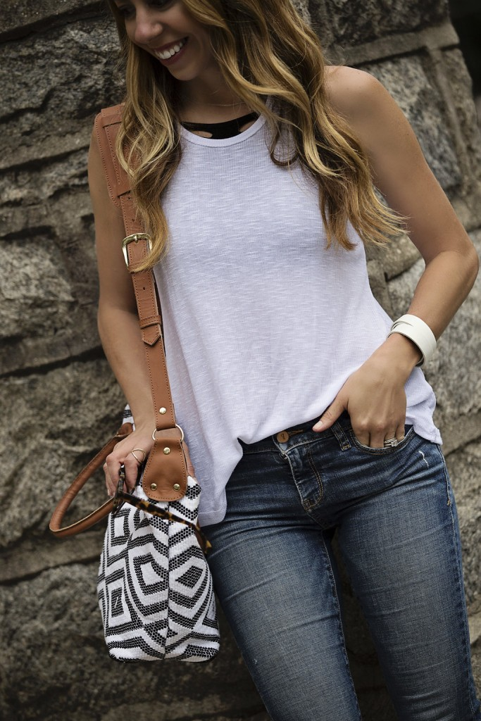 The Motherchic wearing free people tank and tribe alive bag