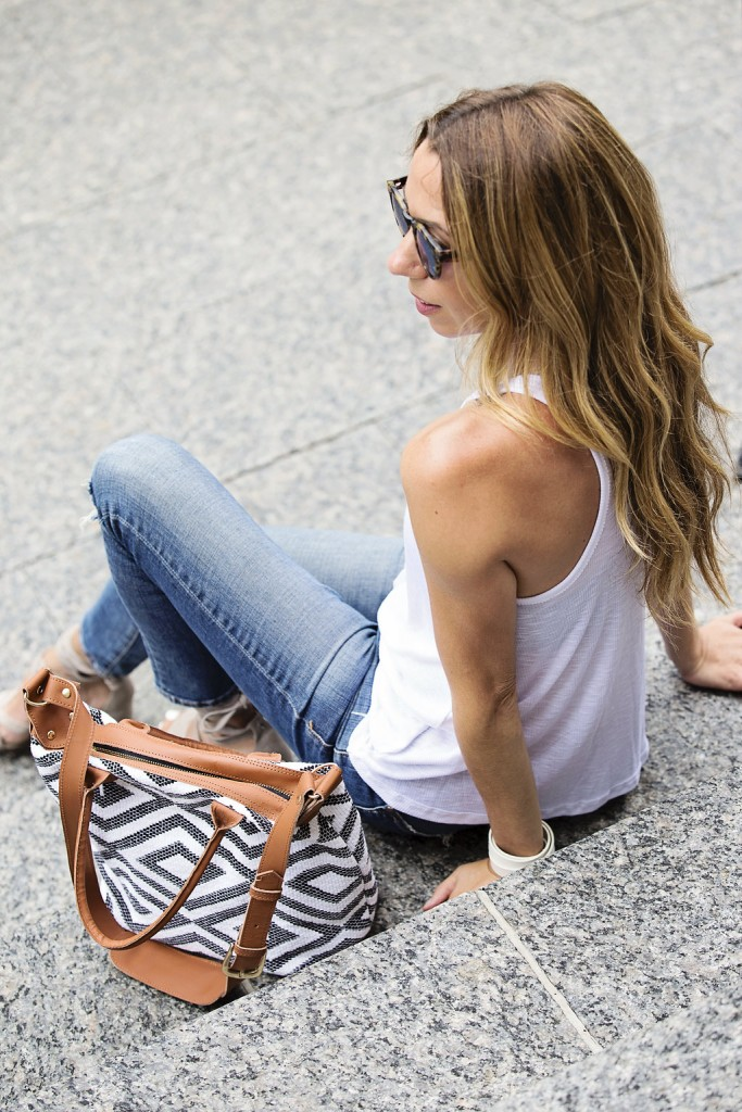 white free people tank and pilcro jeans with tribe alive bag