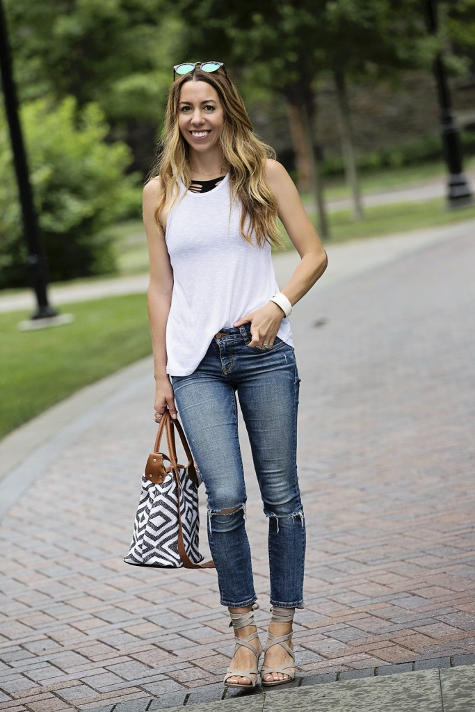 The Motherchic wearing free people tank and pilcro stet jeans with sam edelman sandals