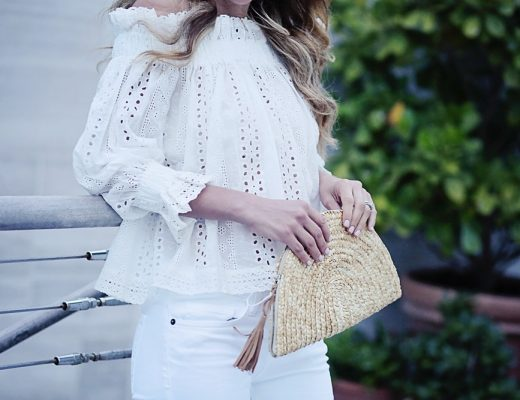 the motherchic wearing white off the shoulder top and straw clutch from tuckernuck