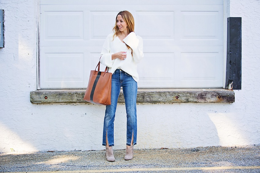 the motherchic wearing frame split hem jeans, toyshop sweater, and madewell tote