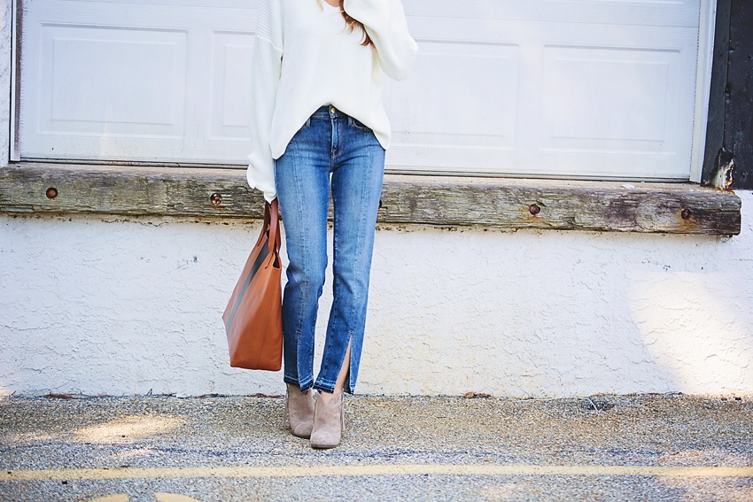 the motherchic wearing split hem jeans by Frame and topshop sweater