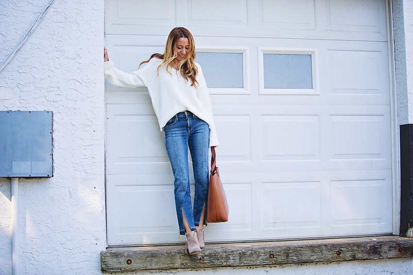 the motherchic wearing frame jeans and topshop sweater