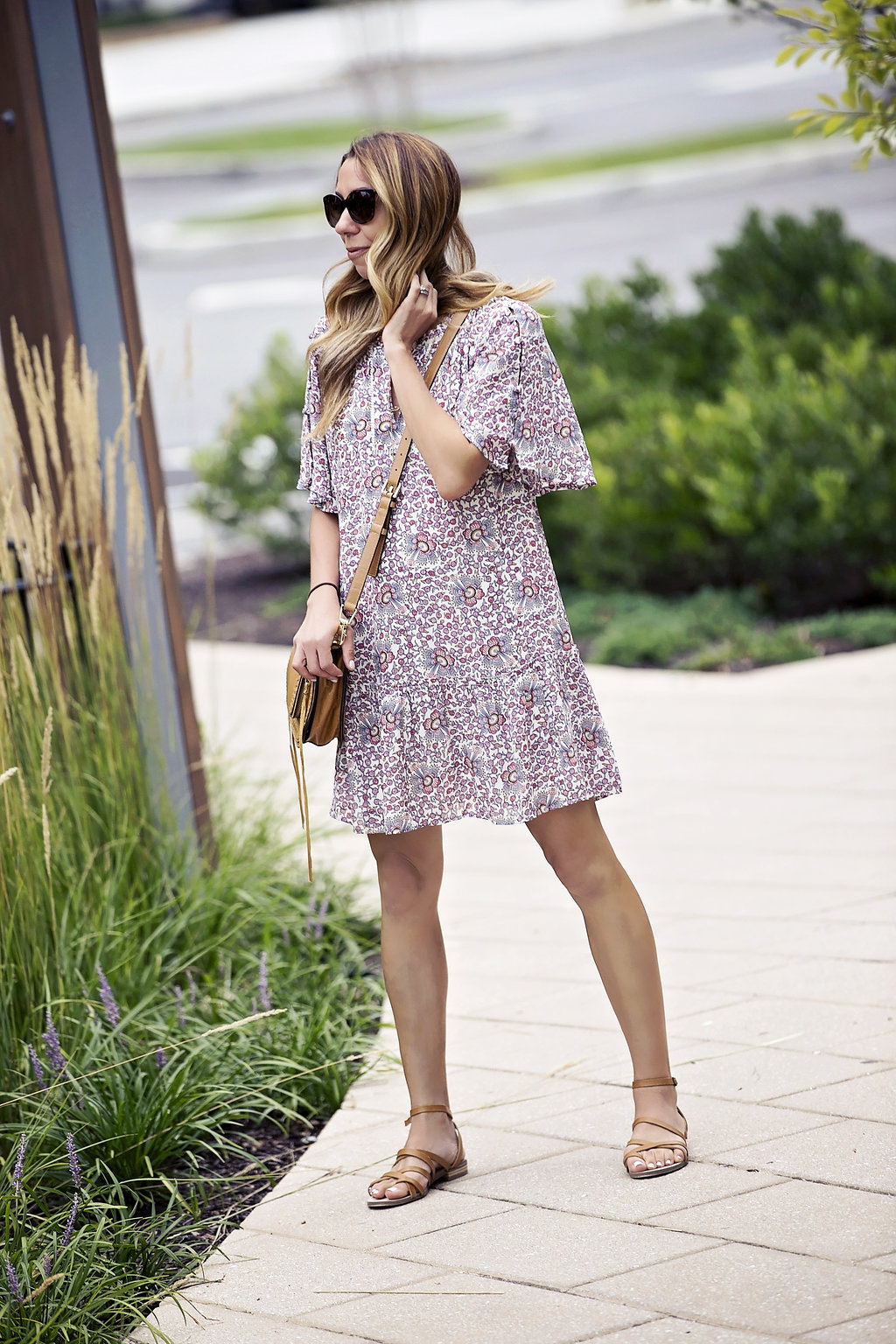 the motherchic wearing floral shift dress from loft