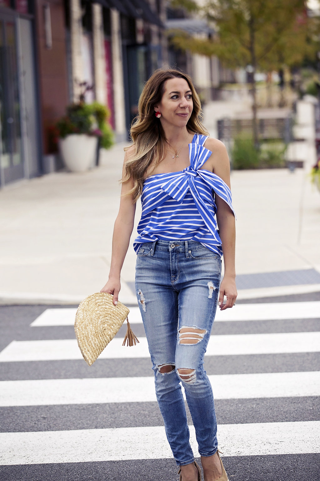 the motherchic wearing j.crew striped one shoulder bow top