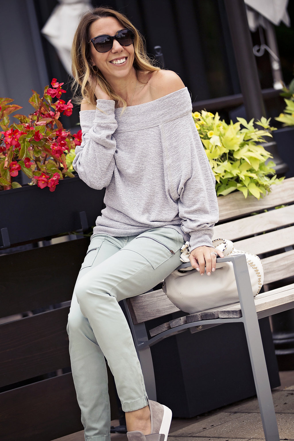 The Motherchic wearing skinny utility pant and off the shoulder sweater