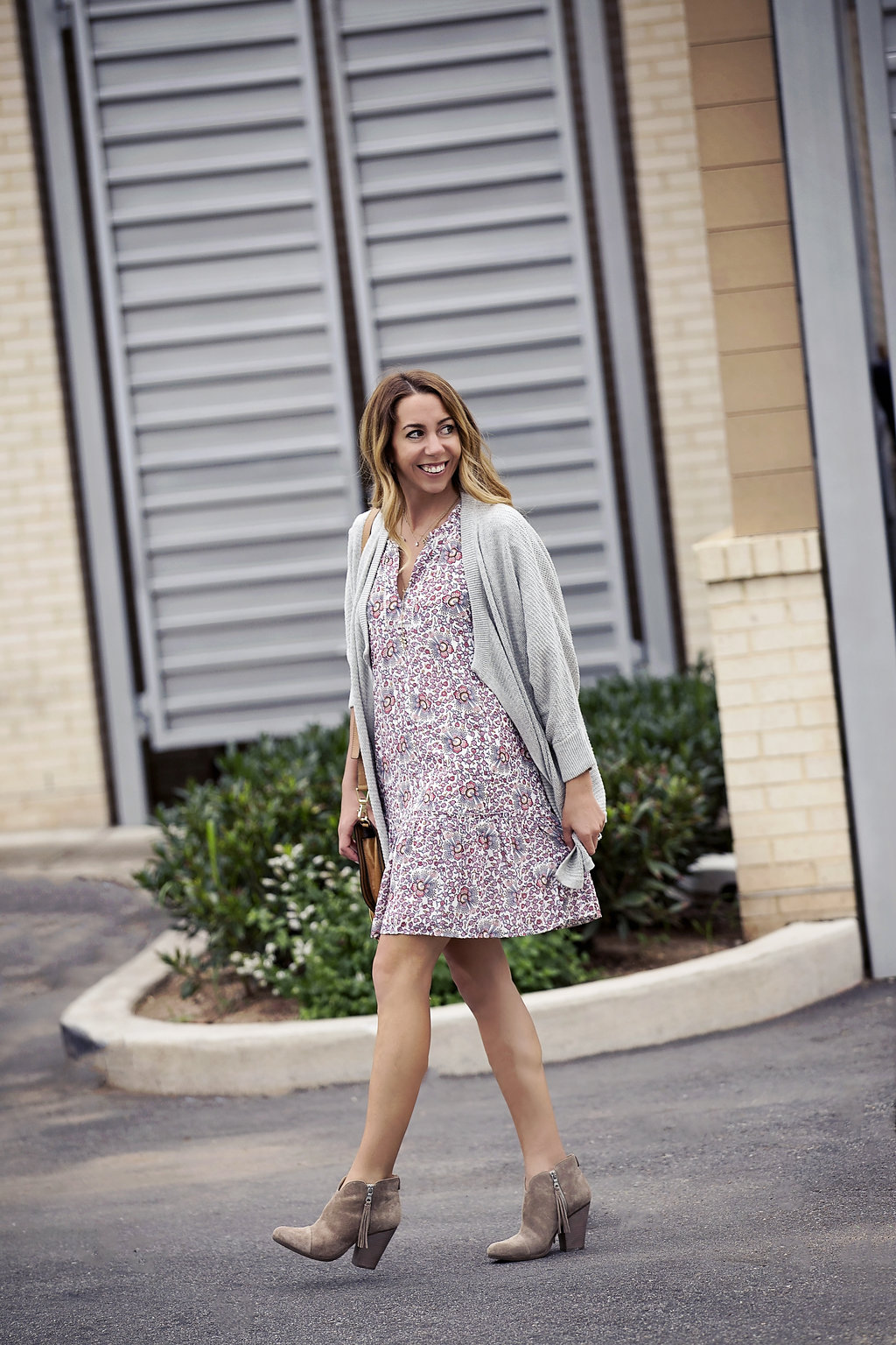 the motherchic wearing loft dress and madewell cardigan