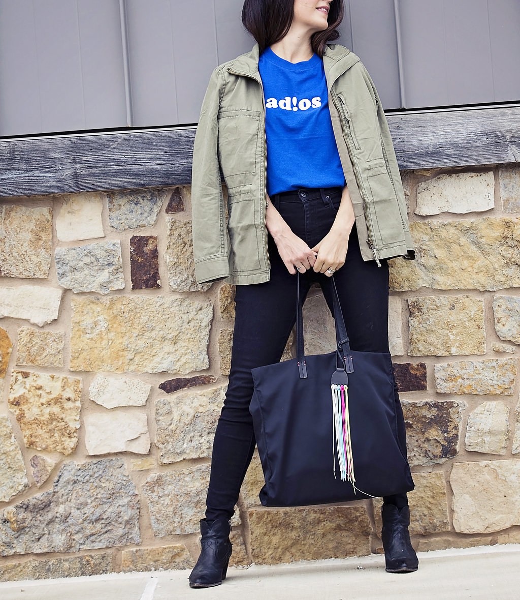 the motherchic wearing adios graphic tee and madewell military jacket
