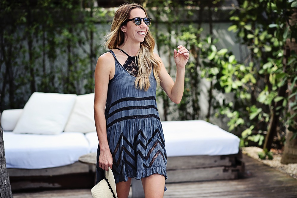 the motherchic wearing free people lace inset tunic