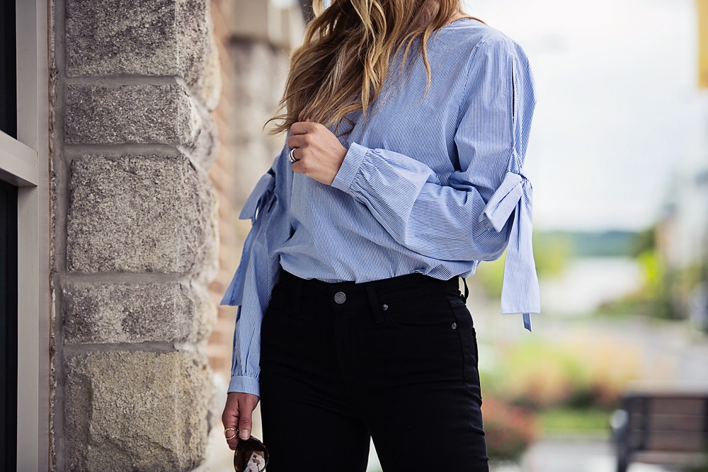 the motherchic wearing bow sleeve top