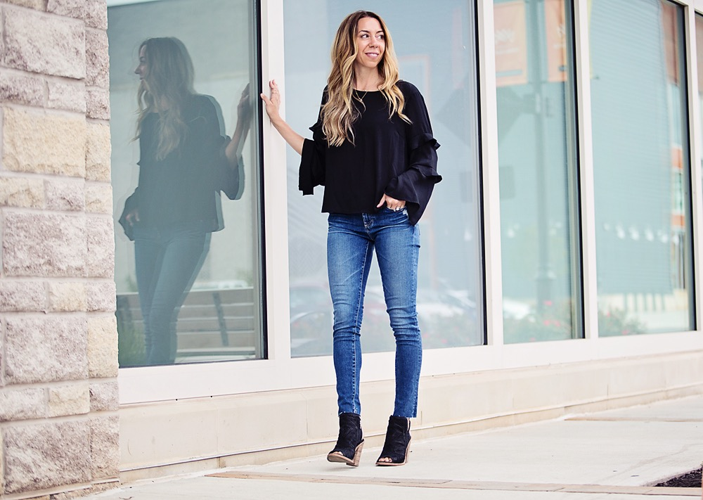 lush ruffle sleeve top with AJ raw hem jeans and open toe booties