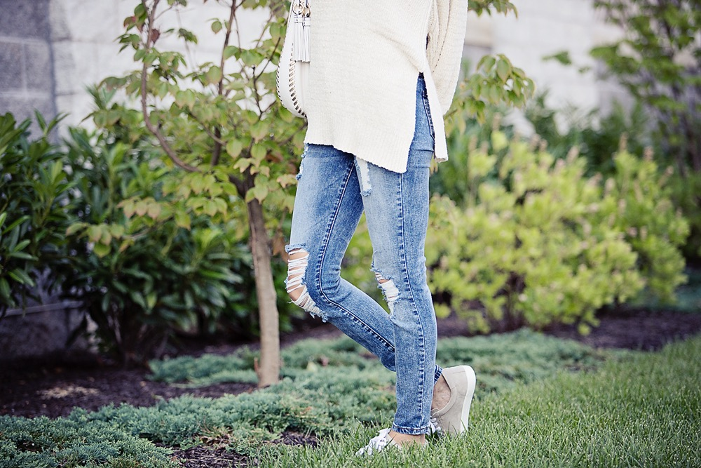 the motherchic wearing distressed jeans by sts blue