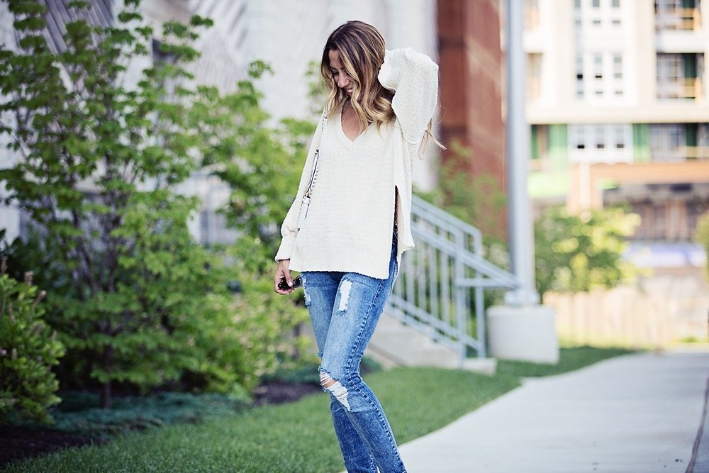 the motherchic wearing free people sweater and sts blue jeans