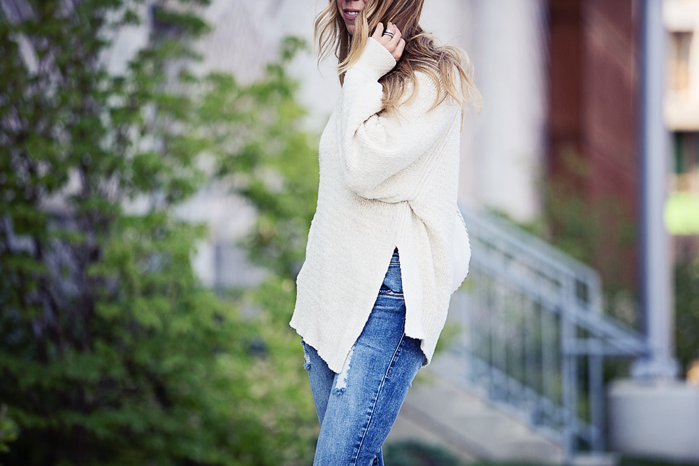 the motherchic wearing neutral knit asymmetrical sweater by free people