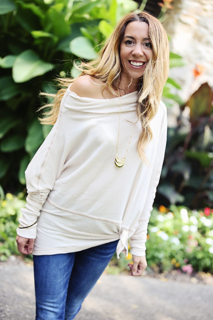 The Motherchic wearing free people tunic and gold pendant necklace