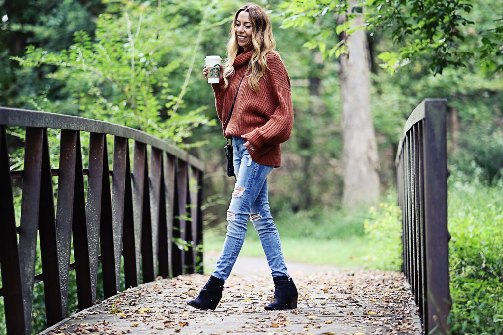 The Motherchic The Motherchic wearing Free People turtleneck sweater and good american jeans with sam edelman booties