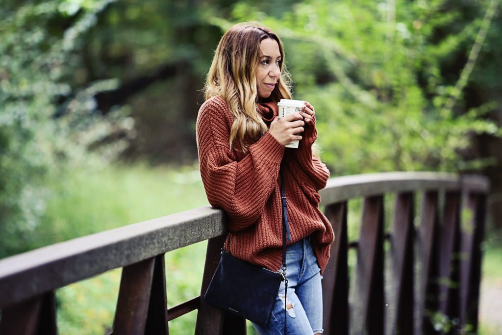 The Motherchic wearing Free People swim too deep turtleneck sweater