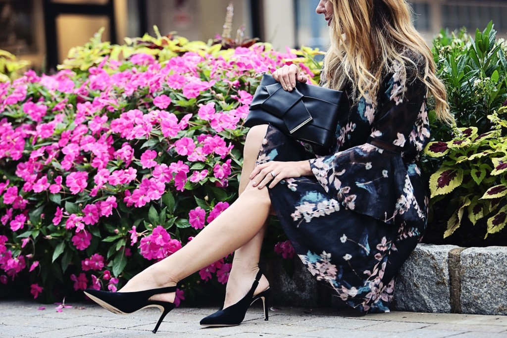 The Motherchic wearing Vince Camuto floral dress and black velvet sling back shoes
