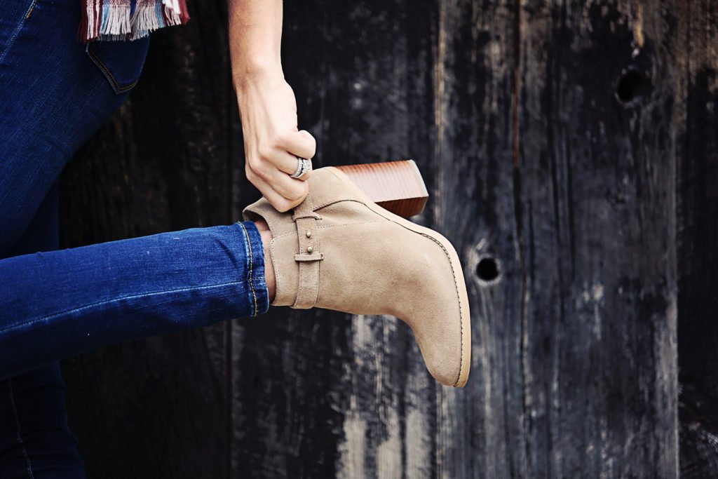 The Motherchic wearing Lyriq heeled ankle bootie