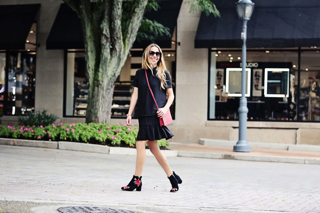The Motherchic wearing Kate Spade crossbody bag and ruffle shift dress