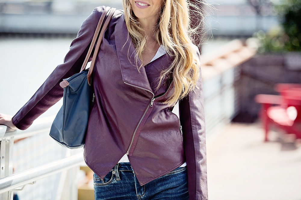 The Motherchic wearing burgundy leather jacket