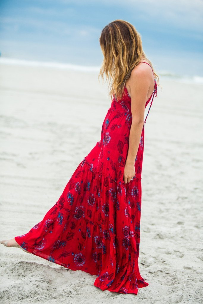 The Motherchic wearing free people garden maxi