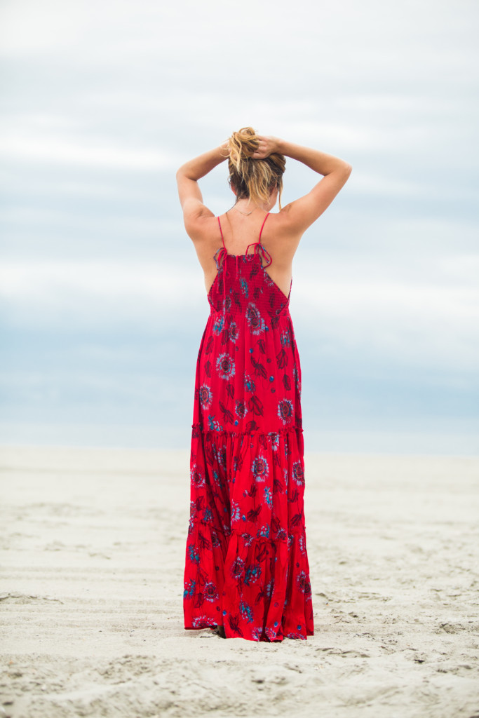 The motherchic wearing red garden maxi dress