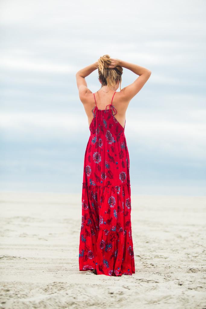 The motherchic wearing red garden maxi dress