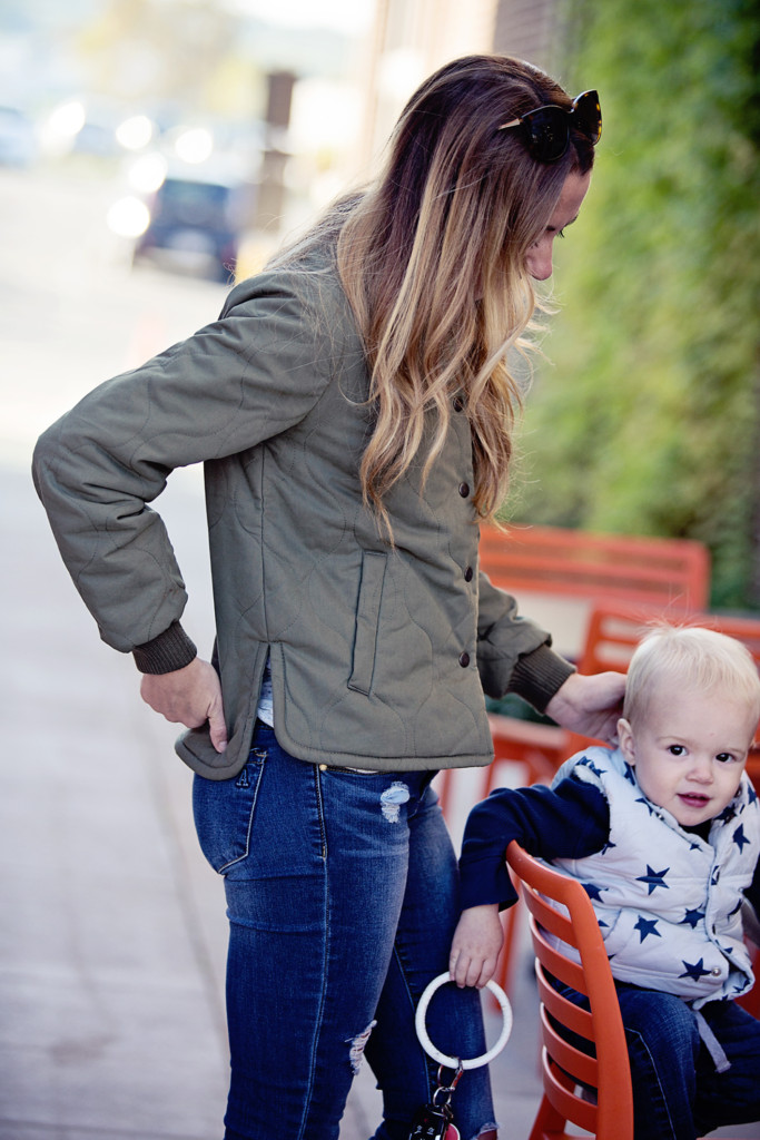 The Motherchic wearing quilted madewell jacket