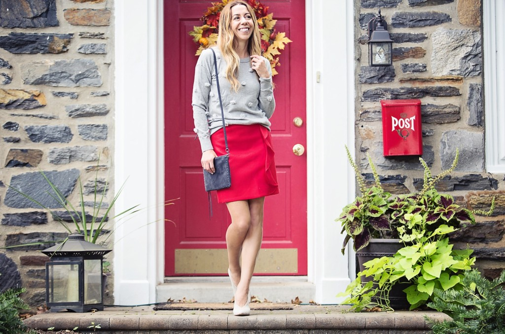 The Motherchic wearing red ruffle mini skirt